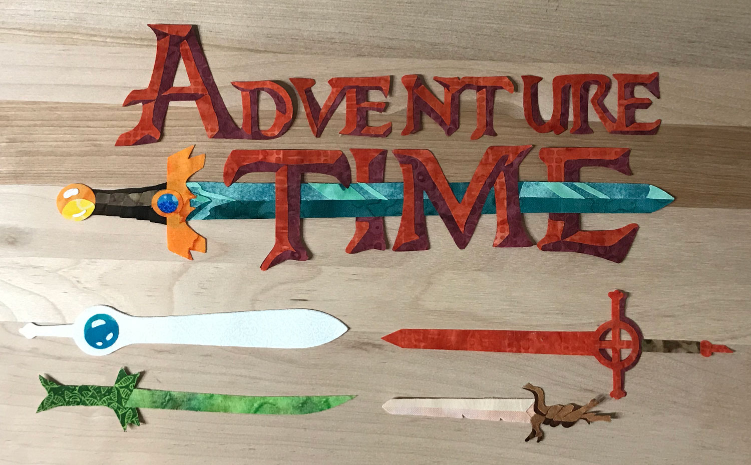 Adventure Time logo and swords